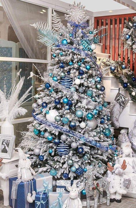 White Christmas Tree With Blue Decorations  from www.weddingflowersinc.com